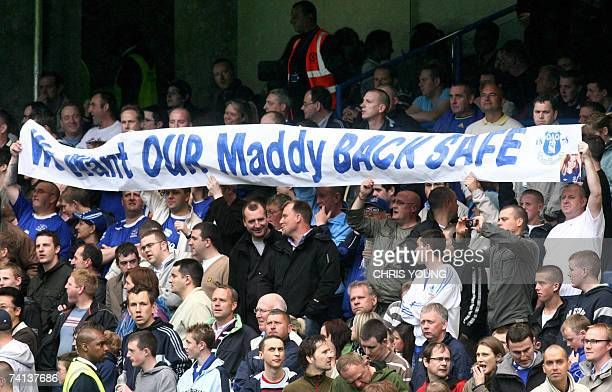 Everton fans hold a banner bearing a message of support for missing British toddler Madeleine McCann prior to the English Premiership match between...