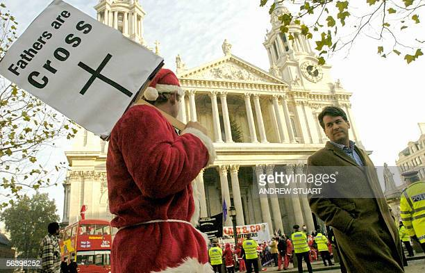 "London, United Kingdom: ""Fathers for Justice"" protestors dressed in Santa Claus suits assemble at St. Paul`s Cathedral in London, 09 December 2005...."