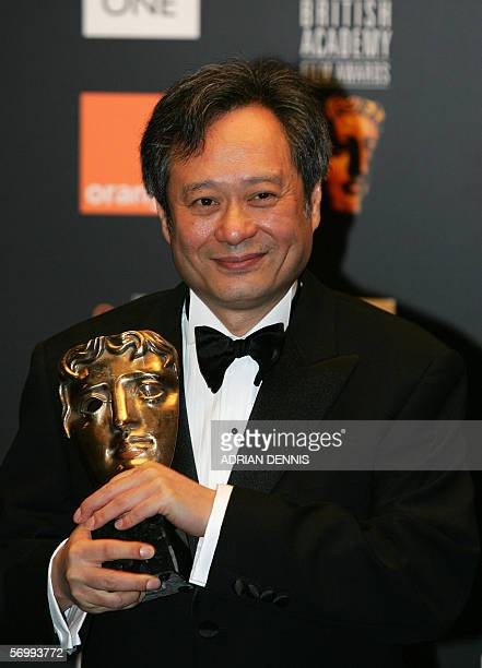 Film director Ang Lee poses for photographs after winning the 'David Lean award for achievement in direction' for the film 'Brokeback mountain' at...
