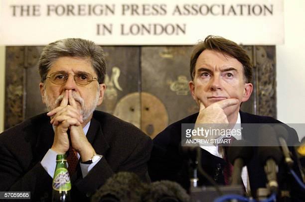 London, UNITED KINGDOM: Finance minister Celso Amorim of Brazil, and EU Trade Commissioner Peter Mandelson listen at a press conference after...