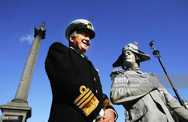 First Sea Lord Admiral Sir Alan West stands beside a 'living statue' dressed and painted as Admiral Horatio Nelson at Trafalgar Square in London 20...