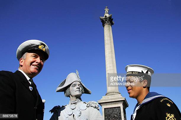 First Sea Lord Admiral Sir Alan West stands beside a 'living statue' dressed and painted as Admiral Horatio Nelson and Sea Cadet at Trafalgar Square...