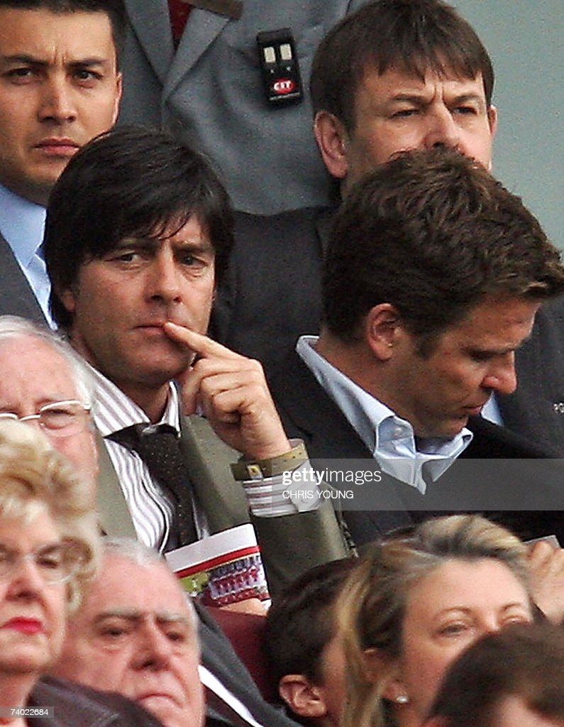 German National coach Joachim Loew (L) sits in the stands with his assistant Oliver Bierhoff (R) at the English Premiership match between Arsenal and Fulham, at the Emirates Stadium, London, 29 April 2007. AFP PHOTO/CHRIS YOUNG Mobile and website uses of domestic English football pictures subject to subscription of a licence with Football Association Premier League (FAPL) tel: +44 207 298 1656. For newspapers where the football content of the printed and electronic versions are identical, no licence is necessary.