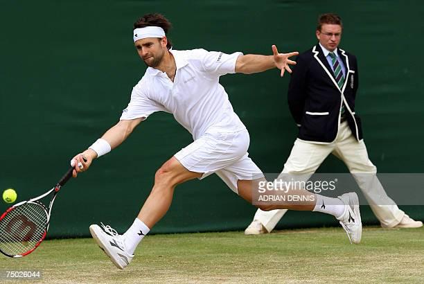 London, UNITED KINGDOM: German Nicolas Kiefer returns the ball to Serbian Novak Djokovic during the 3rd round at the Wimbledon Tennis Championships...