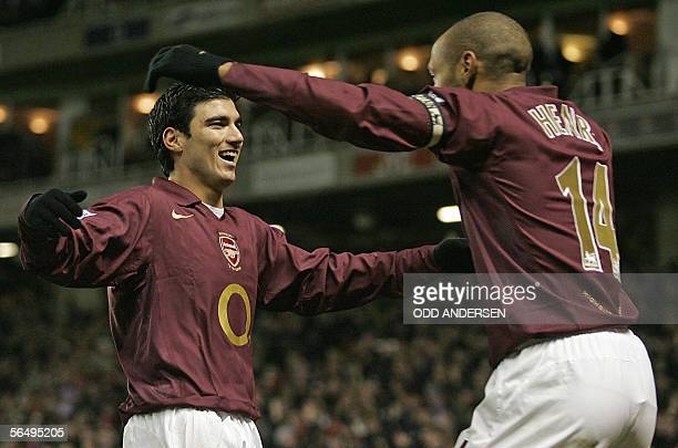 Goal scorer Jose Antonio Reyes of Arsenal celebrates with Frenchman provider Thierry Henry after putting his team two goals up against Portsmouth...