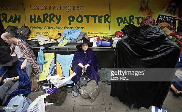 Harry Potter fans queue outside a bookshop in central London 19 July 2007 as they await the release of the latest book by JK Rowling entitled Harry...