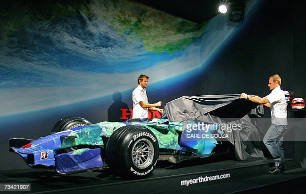 Honda Formula One racing drivers Rubens Barrichello and Jenson Button unveil a Honda Formula One racing car which features a graphic of planet earth...
