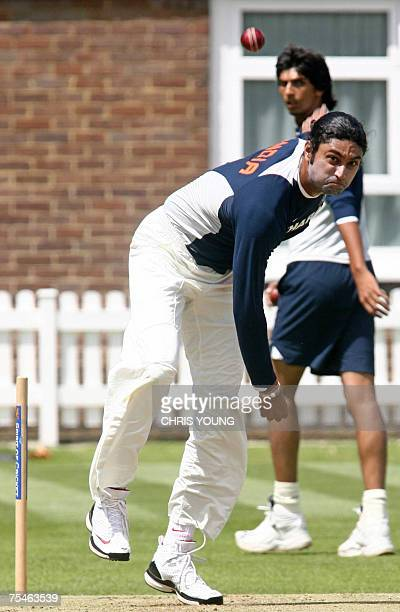 Indian cricketer Ranadeb Bose takes part in a training session at Lords cricket ground 18 July 2007 as Ishant Sharma looks on ahead of the first Test...