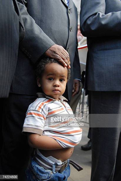 Julien Bancoult grandson of Louis Olivier Bancoult Chairman of the Chagos Refugees Group stands beside his relatives outside The High Court in...