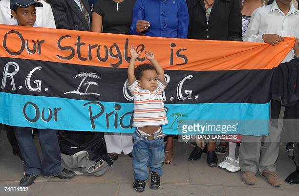 Julien Bancoult the grandson of Louis Olivier Bancoult Chairman of the Chagos Refugees Group celebrates outside The High Court in central London 23...