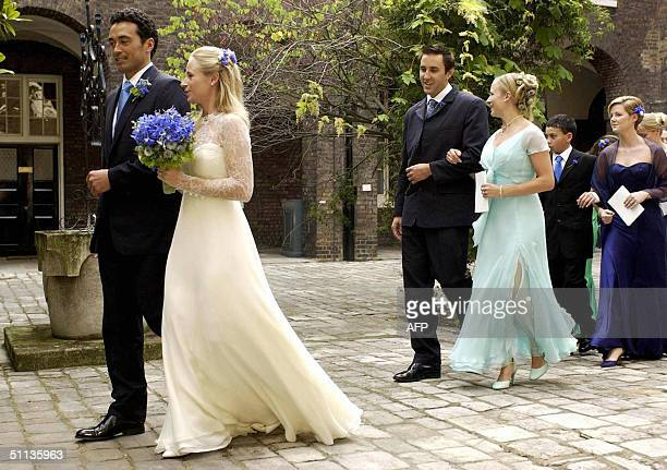 Lady Davina Windsor walks arm in arm with her newly wed husband Gary Lewis outside the chapel at Kensington Palace London 31 July 2004 The 26year old...