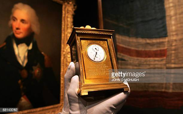Lord Horatio Nelson's pocket watch is displayed in Sotheby's auction house in London 24 June 2005 in front of an iconic painting of Nelson by Lemuel...