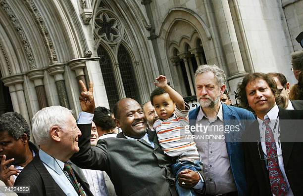 Louis Olivier Bancoult Chairman of the Chagos Refugees Group holds his grandson Julien aloft outside The High Court in central London 23 May 2007...
