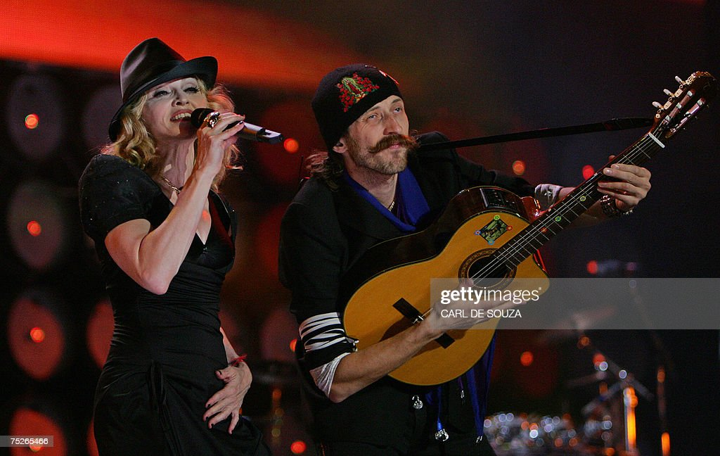 Madonna (L) and Eugene Hutz perform at the Live Earth concert at Wembley stadium in London, 07 July 2007.
