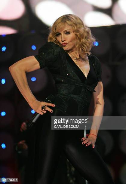 Madonna performs at the Live Earth concert at Wembley stadium in London 07 July 2007 AFP PHOTO/CARL DE SOUZA