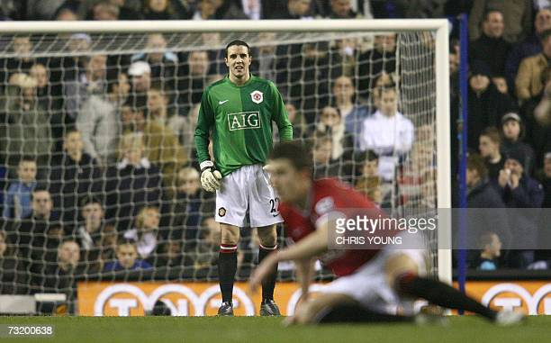 Manchester United's Irish defender John O'Shea takes the goalkeeper's jersey after an injury to Edwin Van Der Sar during the Premiership match...