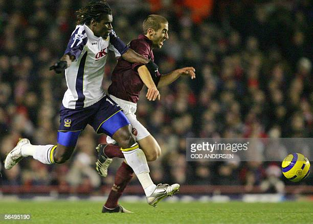 Mathieu Flamini of Arsenal vies for the ball with Aliou Cisse of Portsmouth during a premiership match at Highbury in north London 28 December 2005...