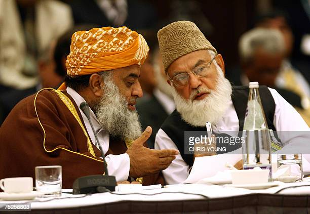 Maulana FazalurRehman the leader of the opposition in the National Assembly in Pakistan confers with Qazi Hussain Ahmed the leader of JamaleIslami 07...