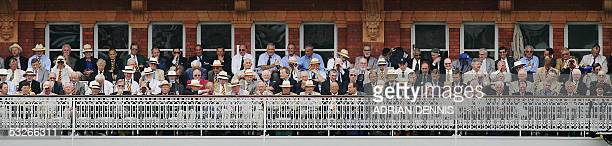 Members of The Marylebone Cricket Club watch from the pavillion as England play Australia during the first test of The Ashes at Lord's cricket ground...