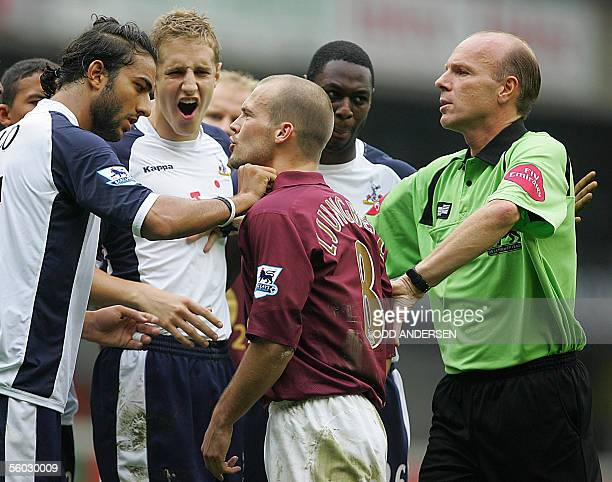 Mido and Michael Dawson of Tottenham has an argument with Fredrik Ljungberg of Arsenal as referee S Bennett tries to calm them down during a...