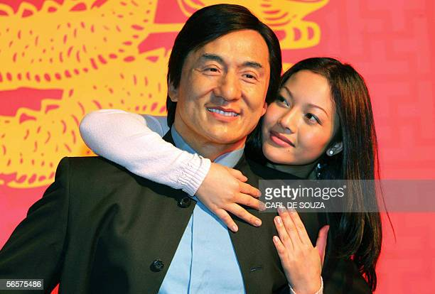 Model Aksorm Ward embraces 12 January 2006 a waxwork sculpture of martial arts actor Jackie Chan as part of Madame Tussauds Chinese New Year...