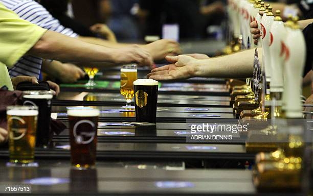 London, United Kingdom: Money and beer swap sides of the bar during the opening day of The Great British Beer Festival in Earls Court exhibition...
