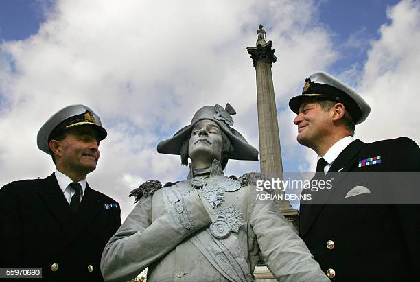 Naval officers stands beside a 'living statue' dressed and painted as Admiral Horatio Nelson at Trafalgar Square in London 20 October 2005 Britain is...