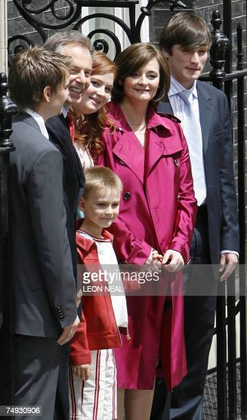 Outgoing British Prime Minister Tony Blair stands with children Euan Kathryn Leo Nicky and his wife Cherie on the steps of 10 Downing Street in...