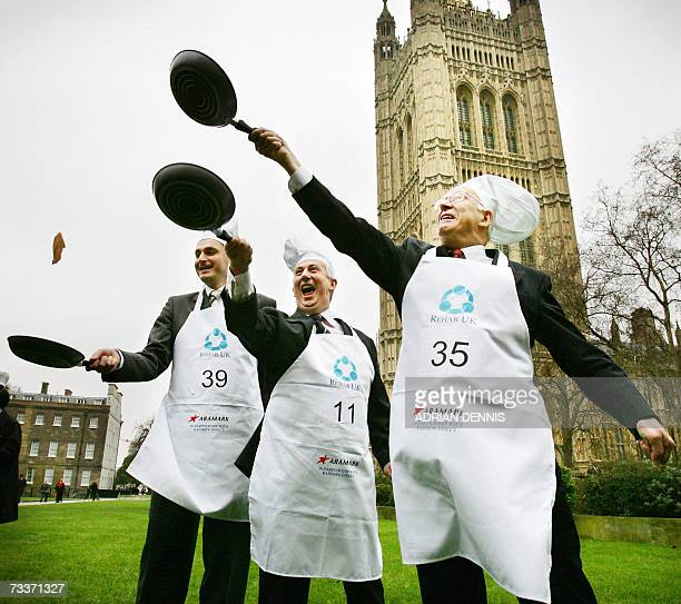 Participants in the '2007 Parliamentary Pancake Race' undertake a practice session on College Green in aid of charity early Shrove Tuesday morning in...