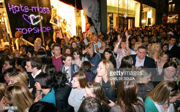 People gather outside a Top Shop store as they wait to catch a glimpse of British Supermodel Kate Moss promoting her new range of clothing in London...