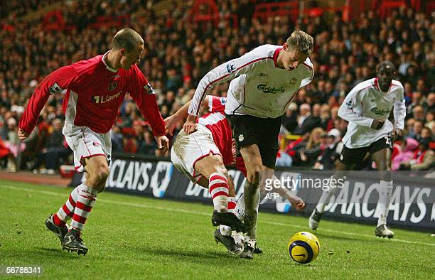 Peter Crouch of Liverpool negotiates a tackle during today in today`s Premiership clash between Charlton Athletic FC and Liverpool FC played at...