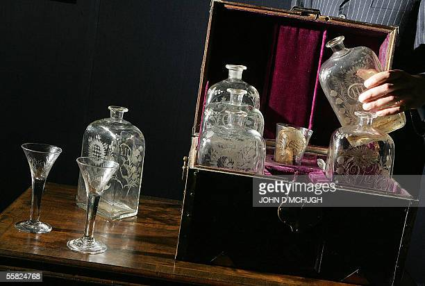Pieces from Lord Admiral Nelson's Grog Chest a velvetlined cased decanter set with wine glasses and beaker are seen in Sotheby's auction house in...
