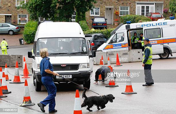 London, UNITED KINGDOM: Police officers check a car in front of the All England Lawn Tennis Club on the 7th Day of the Tennis Championships in...