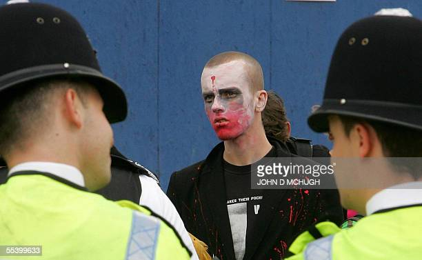 London, UNITED KINGDOM: Police officers contain a group of protesters outside the biannual Defence Systems and Equipment International in London, 14...