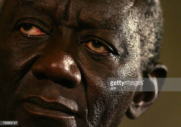 President of Ghana John Agyekum Kufuor listens to reportersduring a joint news conference with Britain's Prime Minister Tony Blair following their...