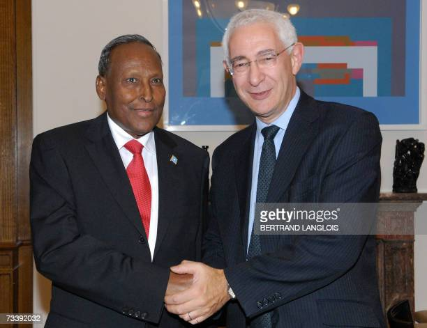 President of the transitional Somalian government Abdullahi Yusuf Ahmed shakes hands with British minister with responsibility for Africa Lord David...