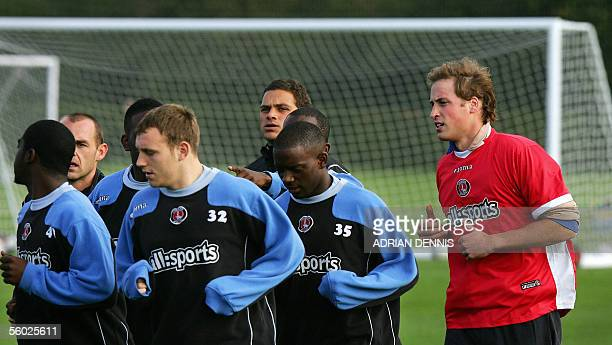 Prince William trains with Charlton Athletic football players during a visit to clubs' training ground in Eltham south London 28 October 2005 ahead...