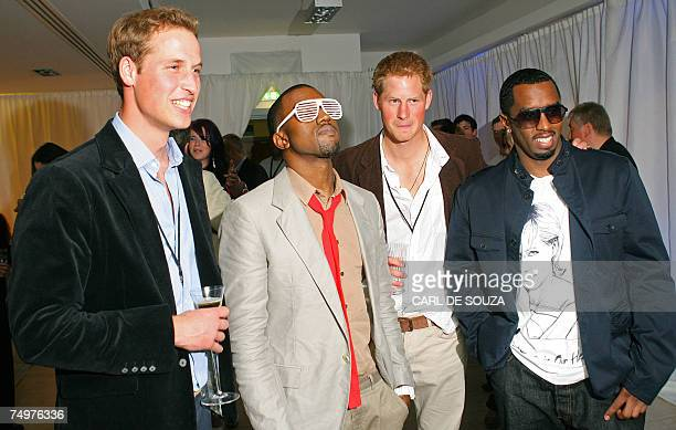 Prince William US rapper Kanye West Prince Harry and US rapper P Diddy pose for the media during a backstage party at Wembley Arena in north London...