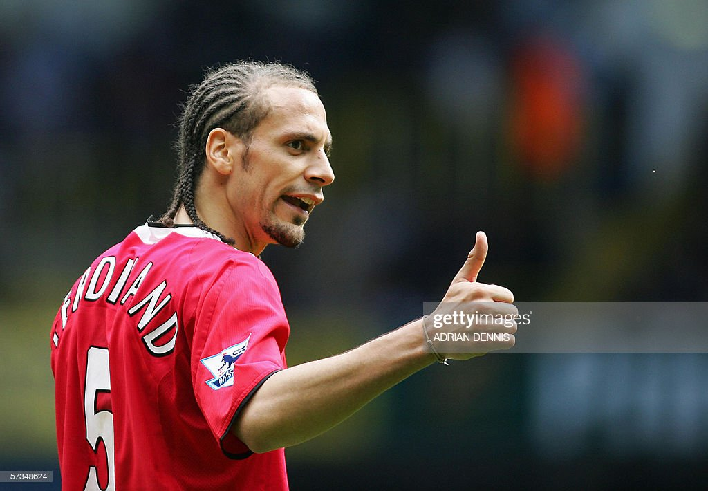 Rio Ferdinand of Manchester United gestures to a teammate against Tottenham Hotspur during the Premiership match at White Hart Lane in London 17 April 2005. Manchester United won the game 2-1. AFP PHOTO ADRIAN DENNIS Mobile and website uses of domestic English football pictures subject to subscription of a license with Football Association Premier League (FAPL) tel : +44 207 298 1656. For newspapers where the football content of the printed and electronic versions are identical, no licence is necessary.