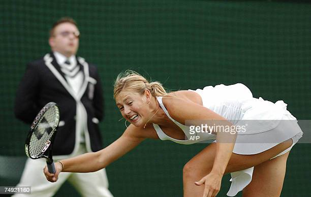 Russian Maria Sharapova returns the ball to China Taipei YungJan Chan during the first round of the Wimbledon Tennis Championships in Wimbledon in...