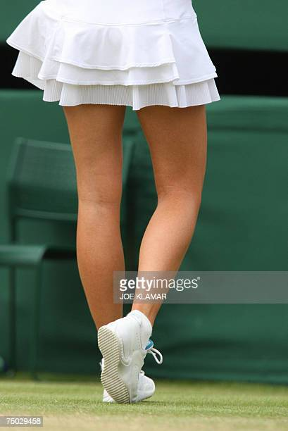Russian Maria Sharapova's legs are pictured as she plays Venus Williams of USA during the fourth round of the Wimbledon Tennis Championships in...