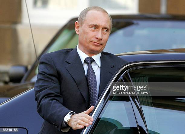 Russian President Vladimir Putin leaves his limousine in front of Lanchaster House in London 04 October 2005 The leaders of Russia and the European...