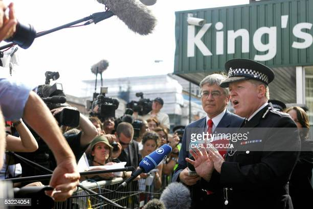 Scotland Yard chief Ian Blair talks to the medai after laying flowers in remembrance of the 07 July London bomb blasts victims at Kings Cross train...