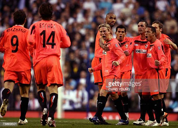 Sevilla's Christian Poulsen leads his team into celebrations after their first goal during the UEFA Cup Quarter final football match between...