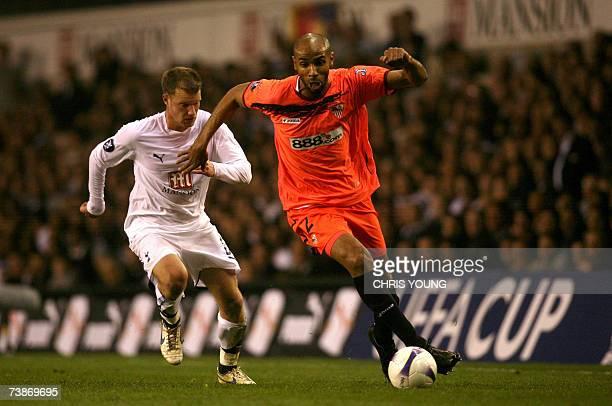 Sevilla's former Tottenham striker Freddie Kanoute takes on Tottenham's Teemu Tainio during their UEFA Cup quarterfinal tie between Tottenham Hotspur...