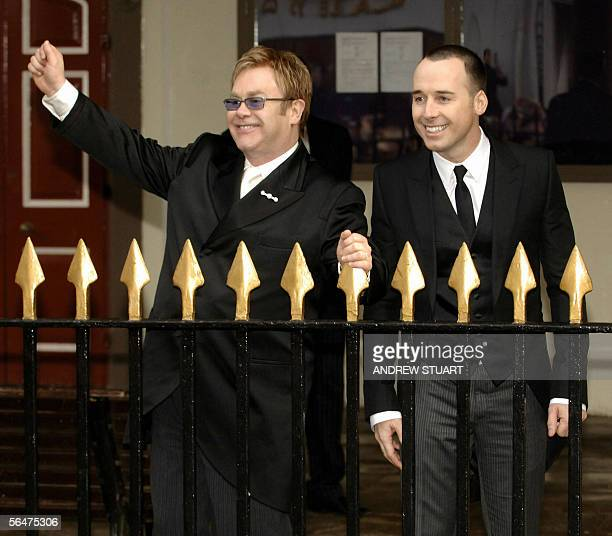 Singer Sir Elton John arrives with his partner David Furnish at the Guildhall in Windsor 21 December 2005 where they will conduct a short civil...