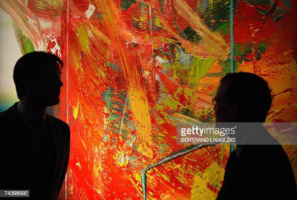 Sothebys auction house employees prepare to exhibit a painting by German artist Gerhard Richter entitled 'Stuhl ' during a photocall at the auction...