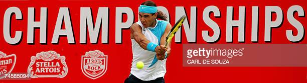 Spanish Rafael Nadal hits a doublehanded backhand to Juan Martin Del Potro of Argentina during their match at the Artois Championship tennis...