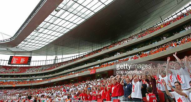 Spectators do the Mexican wave during a pre season 'Dennis Bergkamp' testimonial match between Arsenal and Ajax at Emirates stadium in north London...