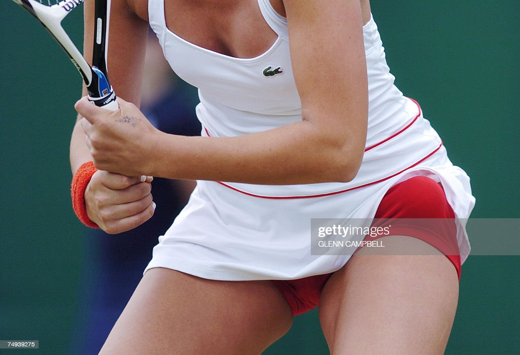 Tatiana Golovin of France returns the ball to Tamira Paszek of Austria during the second round of the Wimbledon Tennis Championships in Wimbledon, in south London, 28 June 2007. Golovin wears red knickers but the All England Club is notoriously strict about all-white clothing on court.
